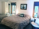 Second large bedroom with 1 queen bed, 1 double bed and washbasin, bedding sheets included