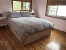 Room 2. Queen bed. Lakeview
