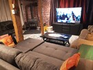 Cocooning & Entertainment corner in the basement along with 2 Sofa-beds and a brand new wood-stove