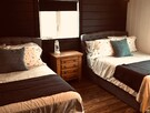 2nd bedroom with two double beds