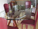 Table in glass and chair in leather