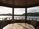 Exterior dining room with lake view