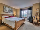 Master bedroom with luxurious linens and King bed with direct access to bathroom